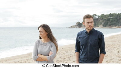 Angry couple walking after argument - Angry couple or...