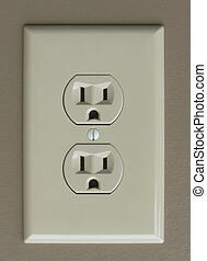 An electric wall outlet with a mad, angry face. Possibly mad because of wasted electricity
