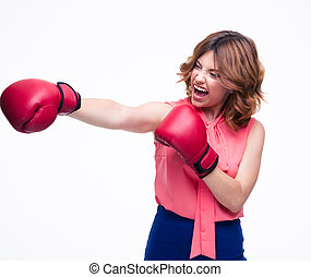 Angry elegant woman with boxing gloves fighting
