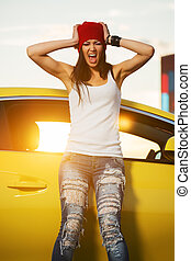 Angry fashion punk woman standing at the car