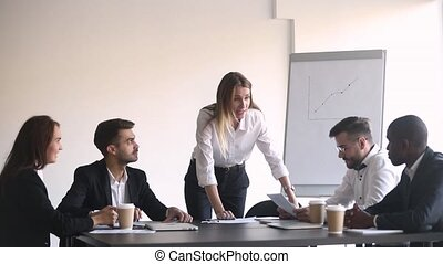 Angry female boss shouting at meeting firing stressed...