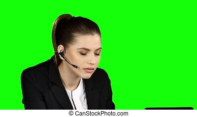 Angry female helpdesk consultant in the office. Green screen...