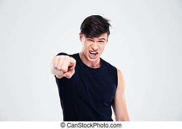 Angry fitness man pointing finger at camera
