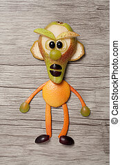 Angry fruit man made on wooden background