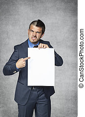 angry frustrated businessman pointing on a sheet of paper