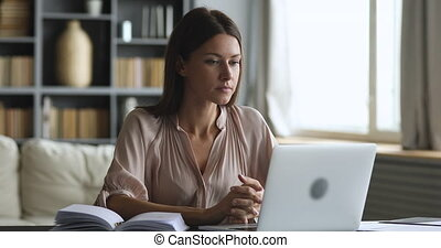 Angry frustrated young woman mad about stuck laptop computer...