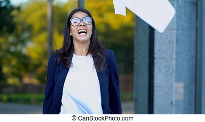 Angry furious female businesswoman screaming in anger. Stress management, mental distress problems, losing temper, reaction on failure. throwing crumpled paper, having nervous breakdown at work.