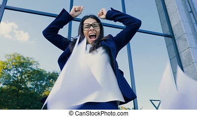 Angry furious female office worker throwing crumpled paper,...