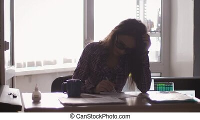 Angry furious pretty female office worker throwing paper, having nervous breakdown at work, slow motion. 3840x2160