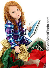 Angry Girl Child Opening an Iron for Christmas