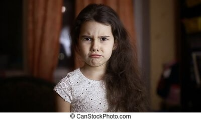Angry girl curls emotion face at home tonight - Angry girl...