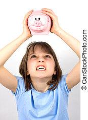 Angry girl shaking piggy bank
