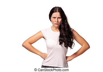 Angry girl standing with hands on waist and looking at camera