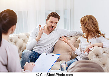 Angry handsome man disagreeing with his wife
