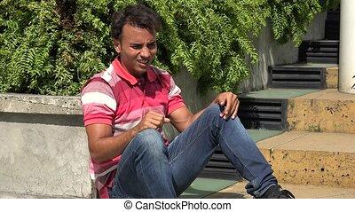 Angry Hispanic Male Sitting