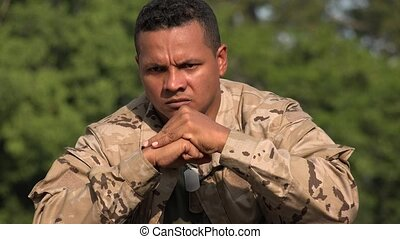 Angry Hispanic Male Soldier Wearing Camo