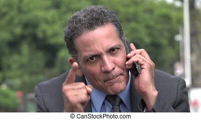 Angry Irate Businessman Using Cell Phone