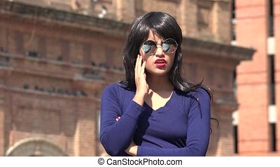 Angry Irate Woman Wearing Sunglasses And Wig