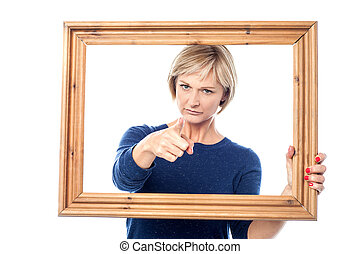 Angry lady holding the wooden frame