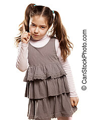 angry little girl shows a finger upwards on white background
