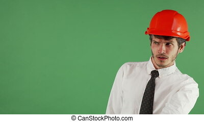 Angry male engineer shouting at someone on chromakey -...