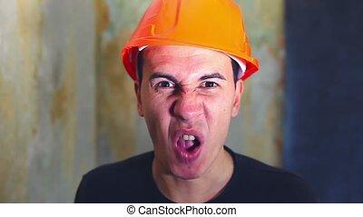 angry man architect builder in helmet swears yells...