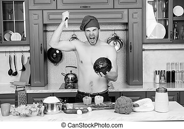 Angry man chef with sexy torso stab knife at cabbage