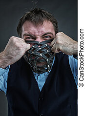Angry man in muzzle