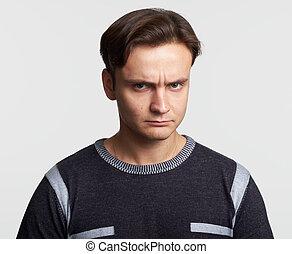 angry man looking at camera. Isolated