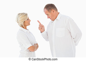 Angry man pointing at his partner on white background