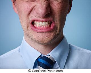 angry man shouting at camera. Close up