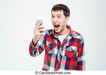Angry man shouting on smartphone