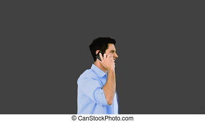 Angry man talking on phone and thro