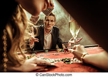 angry man throwing cards while playing poker