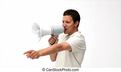 angry man using a megaphone standing against a whit...