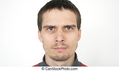Angry man with evil eyes, serious dramatic expression. closeup on a white background