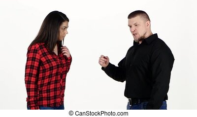 Angry man yelling at frightened woman. Isolated on white background