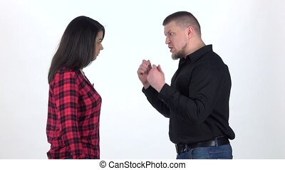Angry man yelling at woman on white background. Slow motion