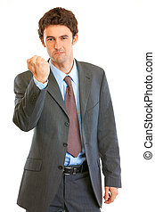 Angry modern businessman threaten with fist isolated on white