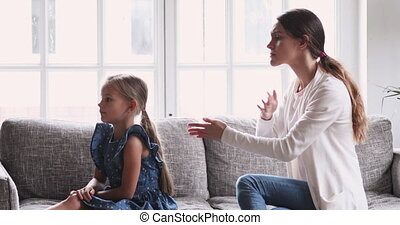 Angry mom scolding stubborn fussy upset little kid daughter