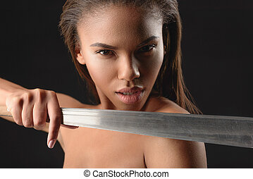 Angry mulatto girl threatening by machete - Defend yourself....