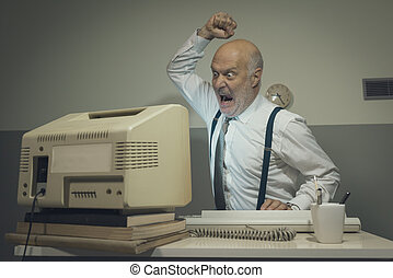 Angry stressed office worker hitting his old broken computer