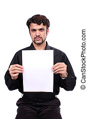Angry Placard - An angry looking young Indian guy holding a...