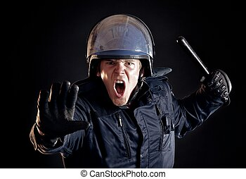 Angry Police Officer Telling Violent Crowd to Stop - Angry...