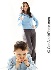 angry punished boy - angry  boy punished by the mother