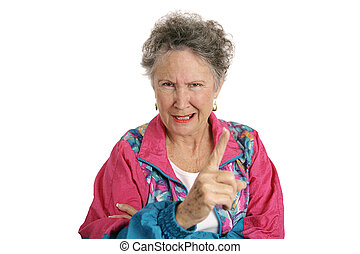 Angry Retiree - A retired senior woman in a track suit...