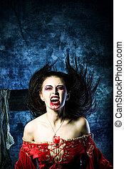 angry roar - Portrait of a bloodthirsty female vampire.