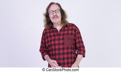Angry senior hipster man complaining to camera - Studio shot...