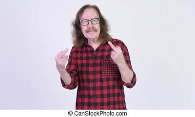 Studio shot of senior hipster man with mustache against chroma key with white background
