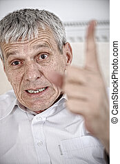 Angry senior man pointing his finger